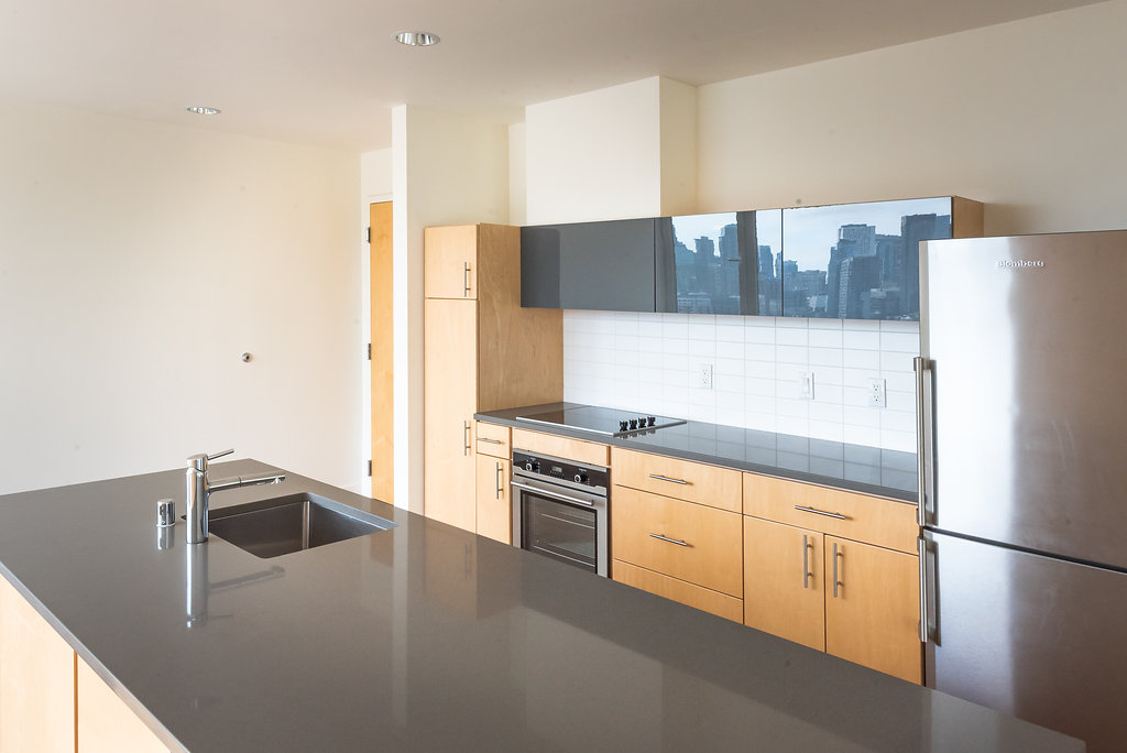 Modern Kitchens With Large Kitchen Islands At Belroy Apartments In Seattle, WA