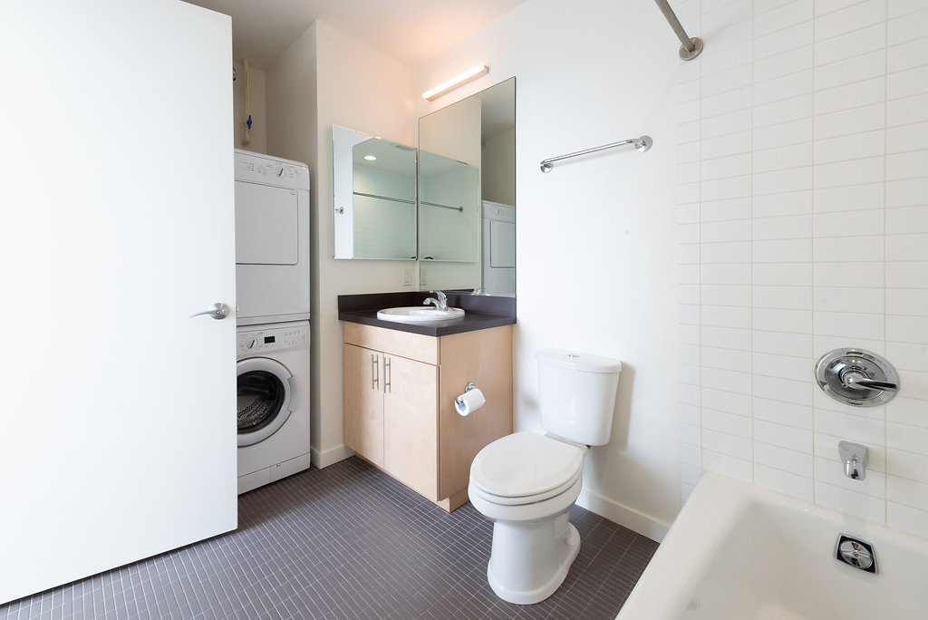Modern Bathroom Layouts With In-Unit Washer & Dryer Sets At Belroy Apartments In Seattle, WA
